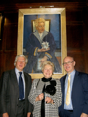 Dame Shirley with Drummond Bone and Professor Green in front of her portrait in hall