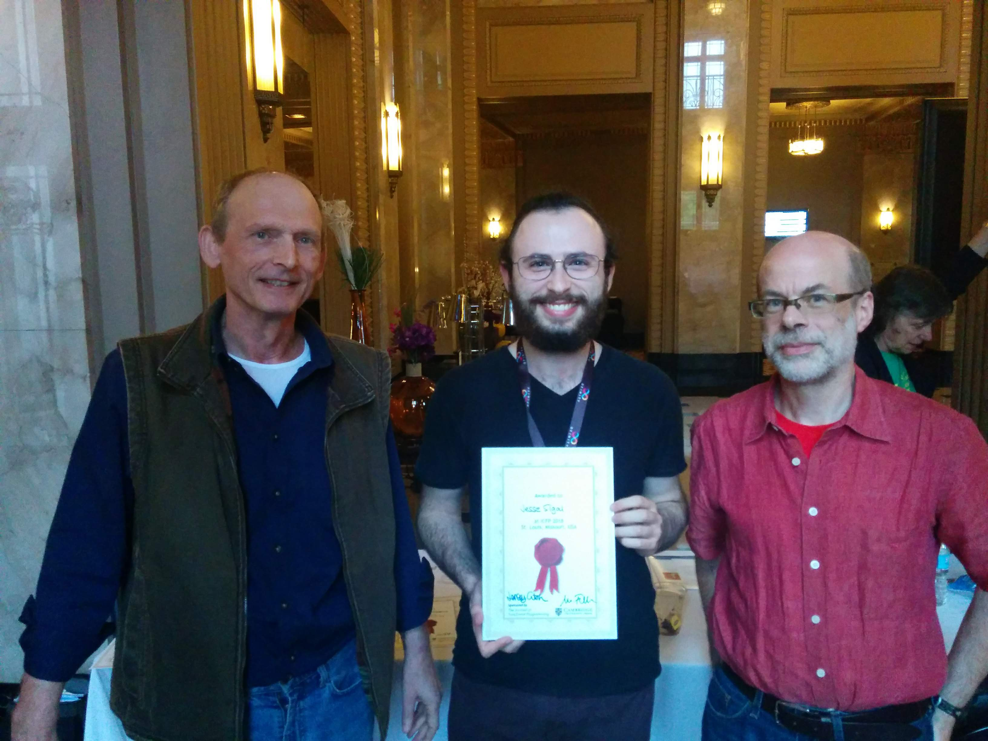 Jesse Sigal (centre)with the Editors of the Journal of Functional Programming, Prof. Matthias Felleisen from Northeastern University Boston (left) and Prof. Jeremy Gibbons from Oxford University