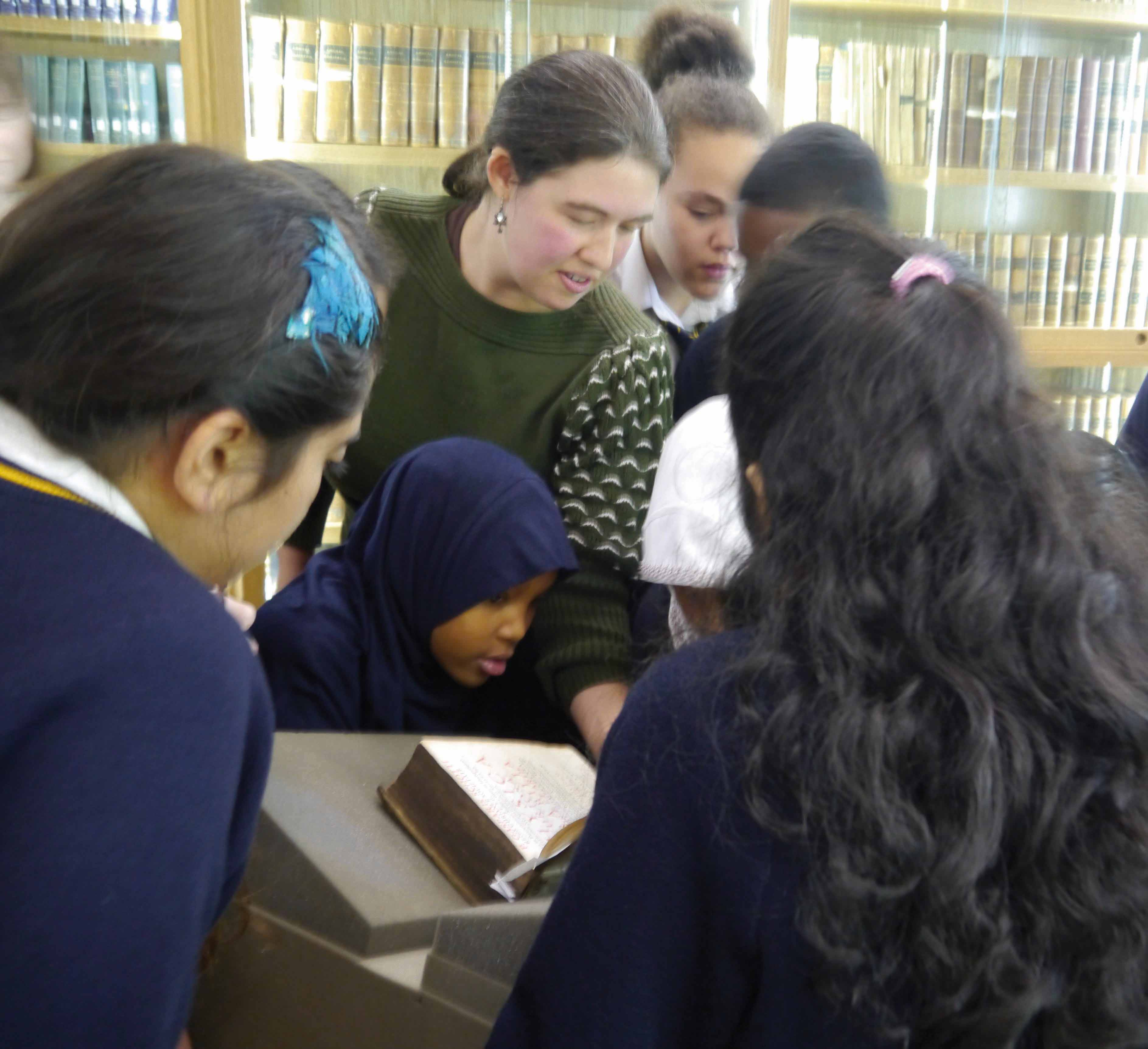 Balliol Librarian with visiting school students